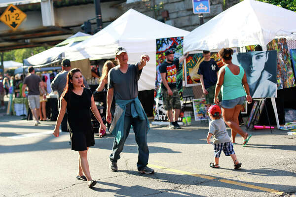 Festival-goers walk down Washington Street at the SoNo Arts Festival in 2015.