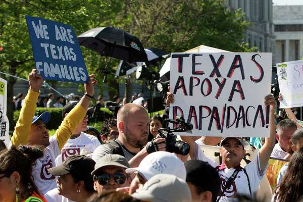 Supporters of fair immigration reform gather in front of the Supreme Court in Washington, in April. On Thursday, the Supreme Court sorely disappointed them, deadlocking on a presidential program that would have allowed an estimated 5 million undocumented immigrants the ability to stay with work permits. The 4-4 vote means an injunction on the program remains in place.