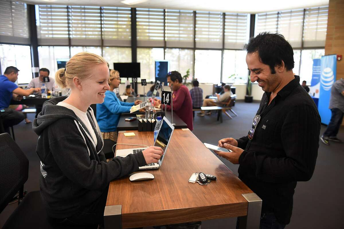 Hannah Rittiman helps out Haroon Malakzai at Uber in Daly City on June 24th, 2016. He is interested in using a rented car from Enterprise Rent-A-Car to work for Uber.