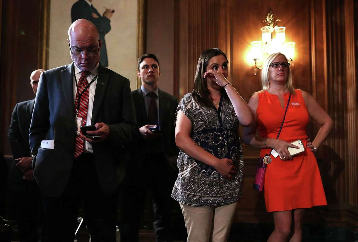 Erica Smegielski, daughter of slain principal Dawn Hochsprung of Sandy Hook Elementary School, wipes away tears as she listens to a news conference after the Senate failed to pass four gun control measures earlier this week. A reader says the problem lies not with guns but with the people who use them.