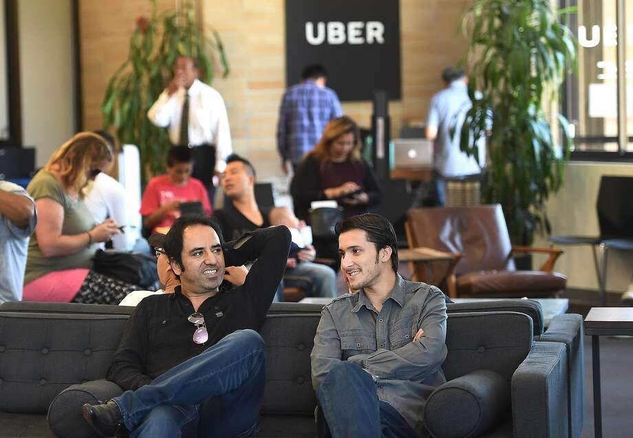 Haroon Malakzai and Ezatullah Mashal wait at Uber in Daly City. Malakzai is interested in using a rented car from Enterprise Rent-a-Car to work for Uber. Photo: Susana Bates, Special To The Chronicle