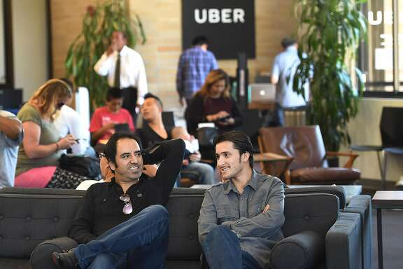 Haroon Malakzai and Ezatullah Mashal wait at Uber in Daly City on June 24th, 2016. Malakzai is interested in using a rented car from Enterprise Rent-A-Car to work for Uber.