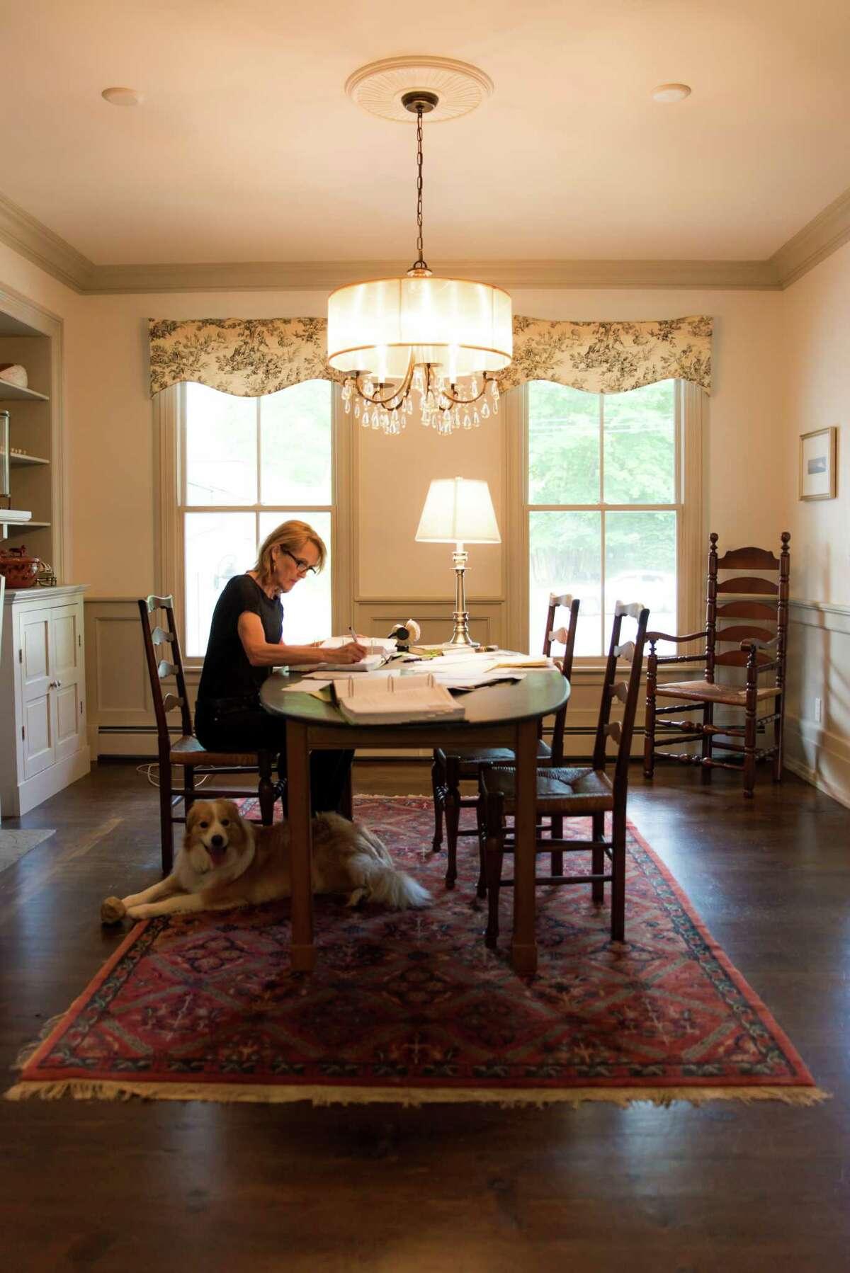 Author Charlotte Rogan at work in her home in Westport.