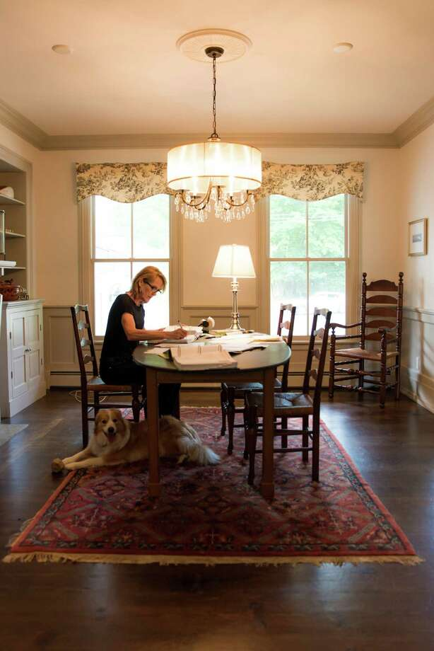 Author Charlotte Rogan at work in her home in Westport. Photo: Kyle Michael King / For Hearst Connecticut Media / Hears Connecticut Media Group Freelance