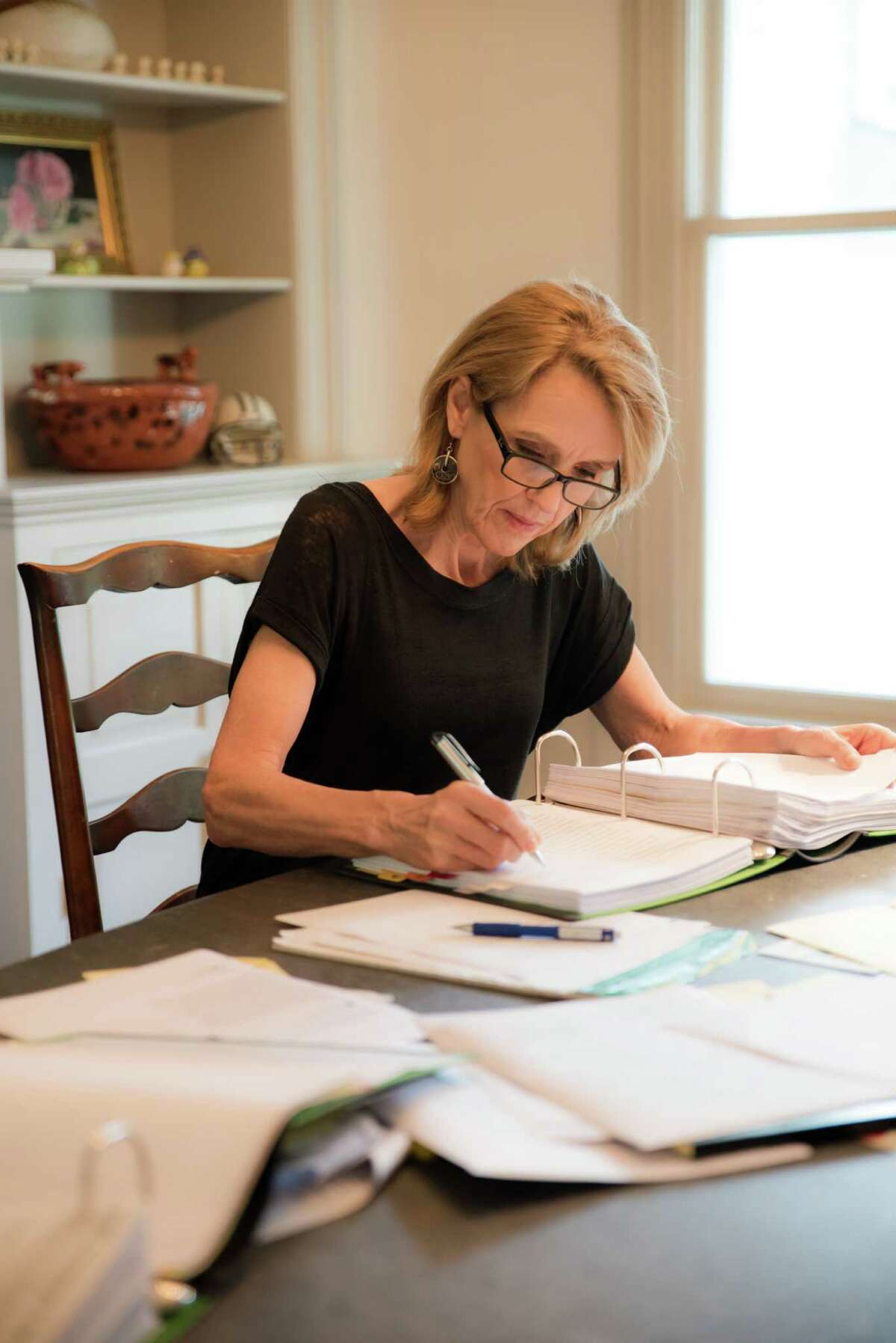 Author Charlotte Rogan at work on her third book in her home in Westport.