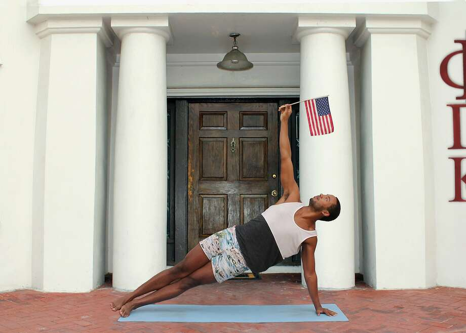 "David Banks demonstrates the Patriotically Inclined pose from the book ""Yoga for Bros."" Photo: Courtesy Hannah Rothstein"