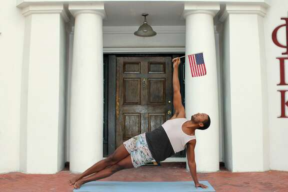 """David Banks demonstrates the """"Patriotically Inclined"""" pose from the book """"Yoga for Bros"""""""