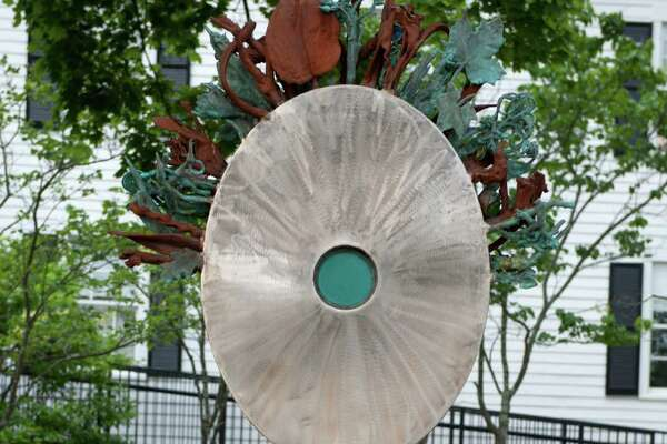"""From May 2016 through 2017, downtown Bethel will feature large outdoor art works created by sculptors from the region. """"Ode to Growth,"""" by artist Glenn Zweygardt, graces the side lawn outside the Bethel Public Library."""