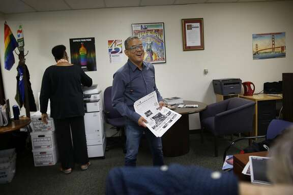 Michael Yamashita (center), publisher, talks with Scott Wazlowski (bottom right), vice president of advertising, and Colleen Small (left), administration as they work at the Bay Area Reporter office on Thursday, June 23, 2016 in San Francisco, California.