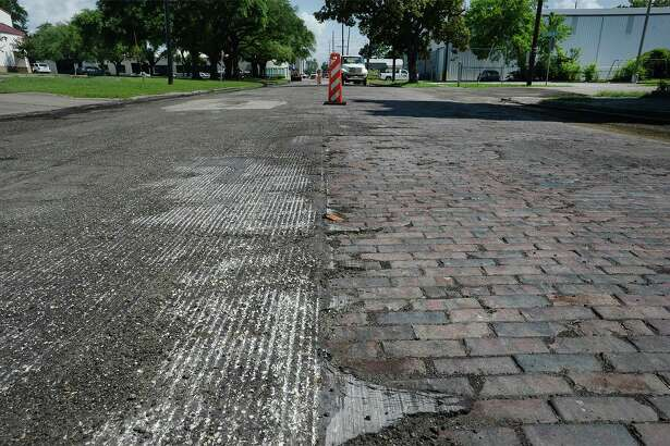 Estimated to predate the Spindletop discovery, a strip of bricks were recently exposed when construction crews began working on North Main in Beaumont.  Photo taken Wednesday, June 22, 2016  Guiseppe Barranco/The Enterprise
