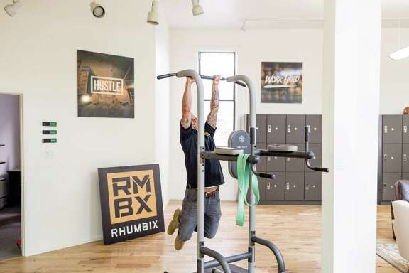Zachary Scheel of Rhumbix, a veteran-focused construction tech startup, works out at the company's office in San Francisco.