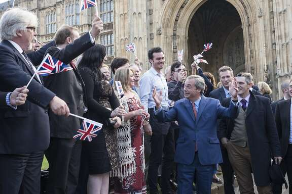 Nigel Farage, leader of the United Kingdom�s Independence Party, speaks to supporters at College Green, a day after Britain voted to break out of the EU, in Westminster, central London, June 24, 2016. The historic decision is sure to reshape the nation�s place in the world, rattle the Continent and rock political establishments throughout the West. �Dare to dream that the dawn is breaking on an independent United Kingdom,� Farage told supporters. (Adam Ferguson/The New York Times)