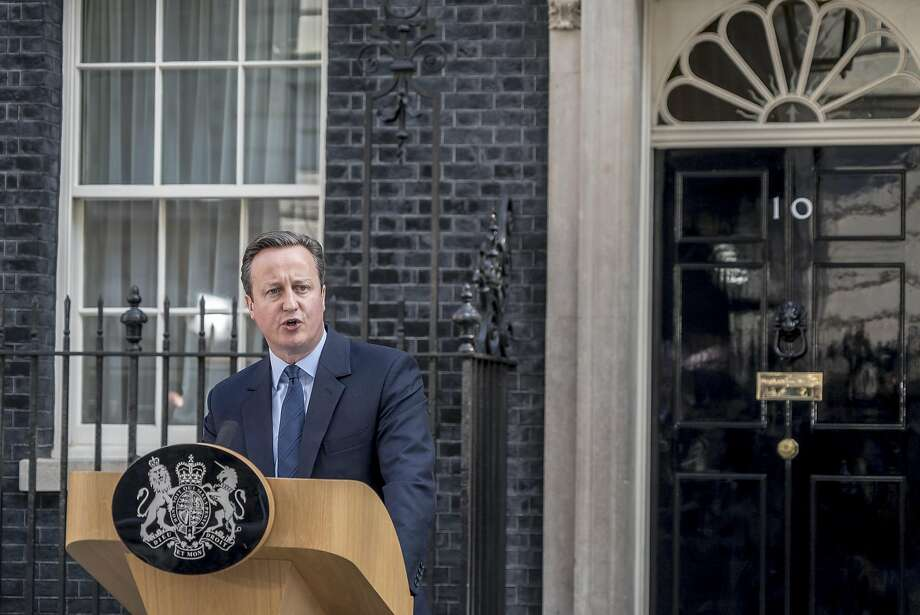 British Prime Minister David Cameron speaks outside 10 Downing Street a day after Britain voted to break out of the European Union, in London, June 24, 2016. Cameron, who led the campaign to remain in the bloc, announced that he planned to step down by October, saying the country deserved a leader committed to carrying out the will of the people. (Andrew Testa/The New York Times) Photo: ANDREW TESTA, NYT