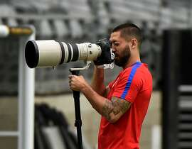 Forward Clint Dempsey plays with a camera before training with other members of the US team at the University of Phoenix Stadium in Phoenix, Arizona, on June 23, 2016, two days before their COPA America 2016, 3rd place final, soccer match against Colombia.  / AFP PHOTO / Mark RalstonMARK RALSTON/AFP/Getty Images