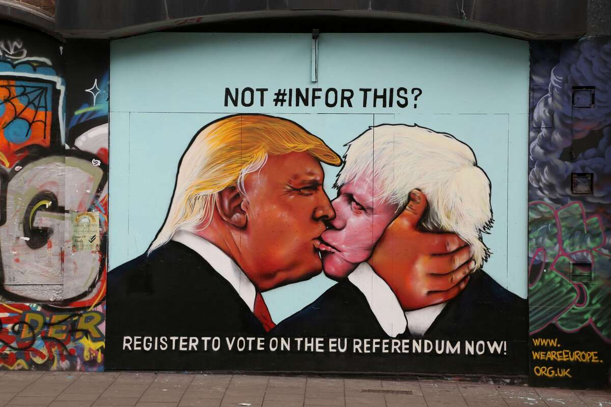 UNITED KINGDOM A mural showing likely US Republican presidential nominee Donald Trump (L) kissing the Former Mayor of London and Conservative MP, Boris Johnson, is pictured on the side of a building in Bristol, southwest England. The mural in Bristol, southwest England, was commissioned by We Are Europe, a campaign group which wants Britain to remain in the European Union at the June 23 vote. The