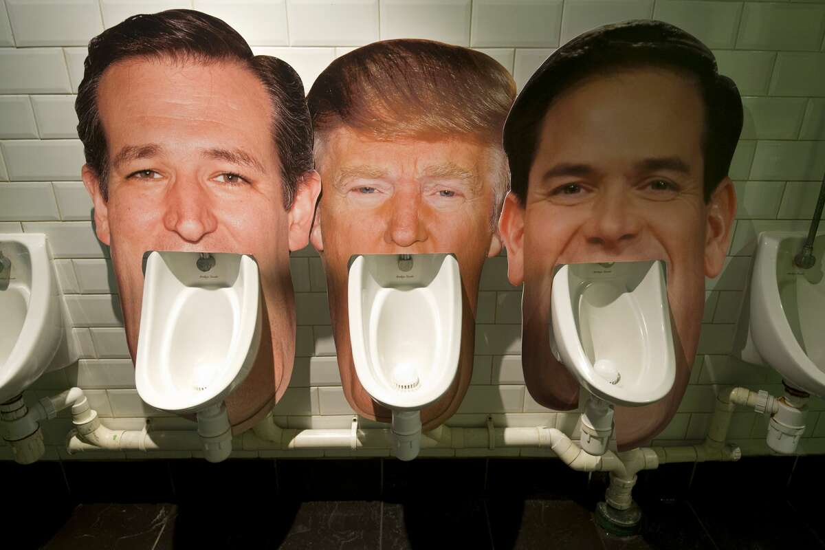 UNITED KINGDOM Cardboard cut outs of the faces of three candidates for the Republican nomination for the 2016 US Presidential election (L-R) Ted Cruz, Donald Trump and Marco Rubio, are seen set up on urinals in a pub in London on March 1, 2016 as part of an informal poll for customers to log which they dislike the most. Part of the satirical television show The Last Leg, customers at the pub are able to choose which urinal to use and then log their poll on a list on the wall afterwards. Trump received enough support from voters to become the Republican Party's presumptive candidate for president.