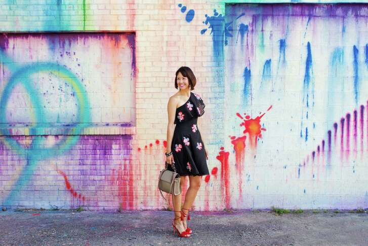Carrie Colbert quit her engeering job earlier this year to focus on her fashion and lifestyle site, Wear & Where & Well, full time. She's wearing a Sachin & Babi dress, Aquazzura heels and an Elena Ghisellini bag.