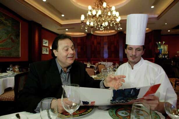 Tony Vallone, owner of Tony's restaurant, discusses the menu with Executive Chef Oliver Ciesielski in 2003.
