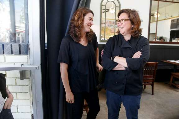 Libby Truesdell (left) and her wife Brenda Buenviaje at the latest restaurant Brenda Meat and Three on Friday, June 24, 2016, in San Francisco, Calif.