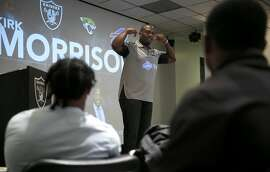 Former Raiders linebacker and current television football analyst Kirk Morrison offers advice to a group of rookies at an orientation session for incoming players at Oakland Raiders team headquarters in Alameda, Calif. on Friday, June 24, 2016.