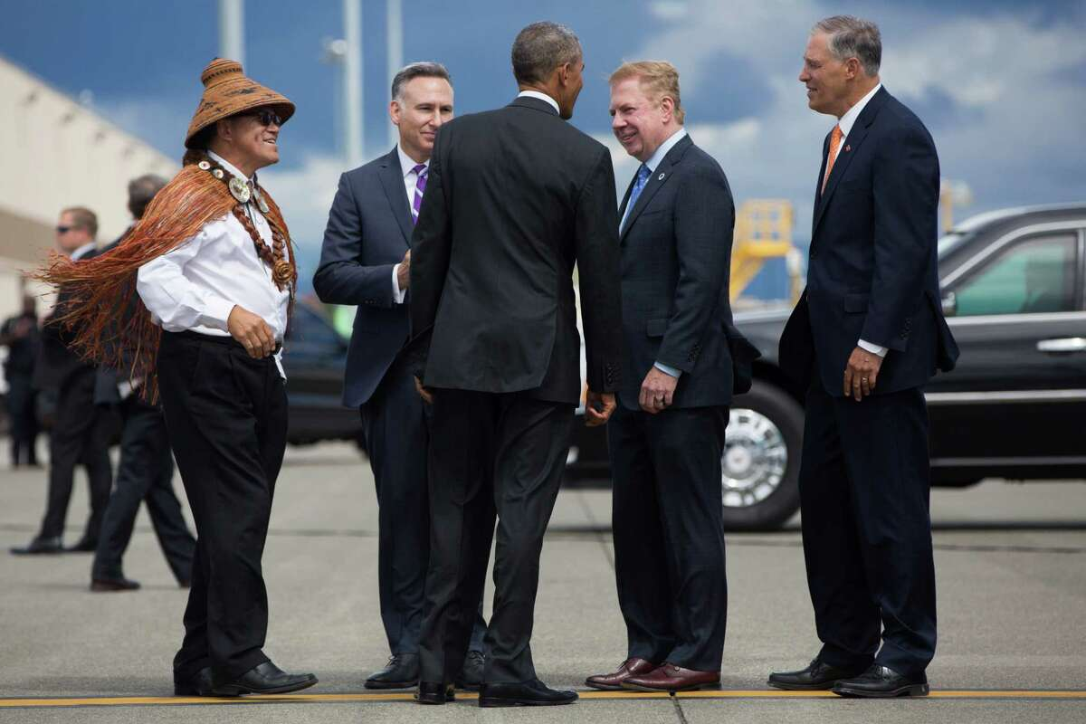 President Barack Obama greets Brian Cladoosby, President, National Congress of American Indians, Dow Constantine, County Executive, King County (D), Ed Murray, Mayor of Seattle (D), and Jay Inslee, Governor of Washington (D) as he exits Air Force One at Seattle-Tacoma International Airport while in town for several fundraisers in the Seattle area on Friday, June 24, 2016.