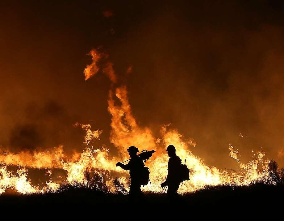Firefighters battle Kern County's devastating Erskine Fire in 2016 by lighting backfires in Lake Isabella. Photo: Casey Christie, Associated Press