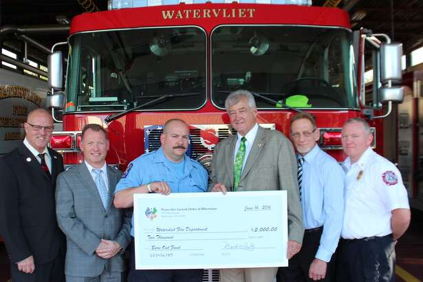 Watervliet Mayor Mike Manning was joined by members of the City's Fire Department and the Watervliet Ancient Order of Hibernians to accept a check for $2,000 for the City's Burn Out Fund at a ceremony at the Fire Department on Thursday, June 16. The donation is a result of the Ancient Order of Hibernian's Christmas tree sales from the last two years. Pictured (L-R) are: Bruce Hidley, Watervliet Ancient Order of Hibernians; Watervliet Mayor Mike Manning; Jody Legault, Watervliet Firefighter and Union President; Mark Scully, President of the Watervliet Ancient Order of Hibernians; Mike Price, Watervliet Ancient Order of Hibernians; and Rob Conlen, Chief of the Watervliet Fire Department.