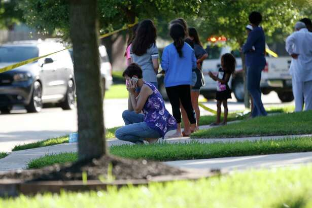 Neighbors gather to watch as Fort Bend County Sheriffs department investigates  a shooting at Blanchard Grove and Remson Hollow, Friday, June 24, 2016, in Katy.