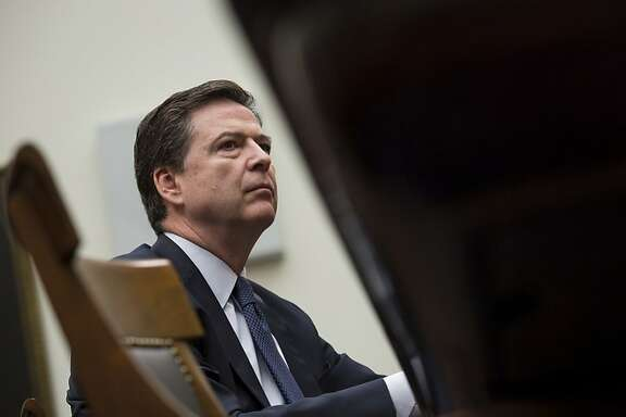 """WASHINGTON, DC - MARCH 1: Federal Bureau of Investigation Director James Comey testifies during a House Judiciary Committee hearing titled """"The Encryption Tightrope: Balancing Americans' Security and Privacy,"""" on Capitol Hill, March 1, 2016 in Washington, DC. Apple is fighting a court order requiring them to assist the FBI in opening the encrypted iPhone belonging to San Bernardino shooter Syed Farook. (Drew Angerer/Getty Images)"""