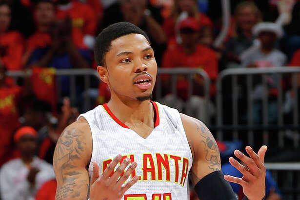 ATLANTA, GA - MAY 06:  Kent Bazemore #24 of the Atlanta Hawks reacts after hitting a three-point basket against the Cleveland Cavaliers in Game Three of the Eastern Conference Semifinals during the 2016 NBA Playoffs at Philips Arena on May 6, 2016 in Atlanta, Georgia.  NOTE TO USER User expressly acknowledges and agrees that, by downloading and or using this photograph, user is consenting to the terms and conditions of the Getty Images License Agreement.