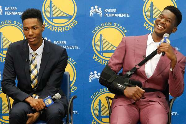 New draft picks Patrick McCaw, left, and Damian Jones field questions at the Warriors practice facility in Oakland, Calif., on Friday, June 24, 2016.