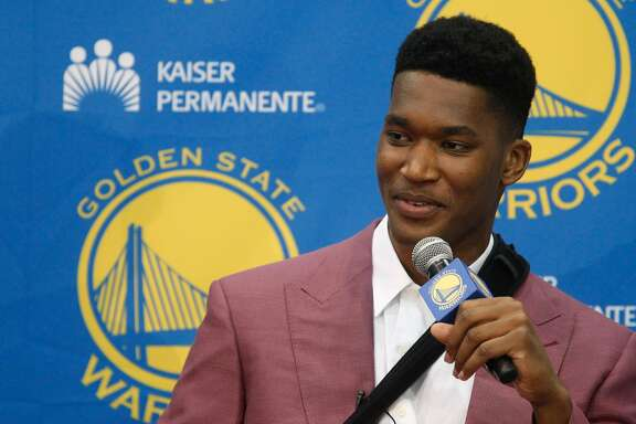 New draft pick Damian Jones answers a question at the Warriors practice facility in Oakland, Calif., on Friday, June 24, 2016.