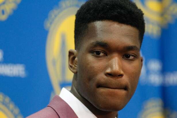 New draft pick Damian Jones listens to a question at the Warriors practice facility in Oakland, Calif., on Friday, June 24, 2016.