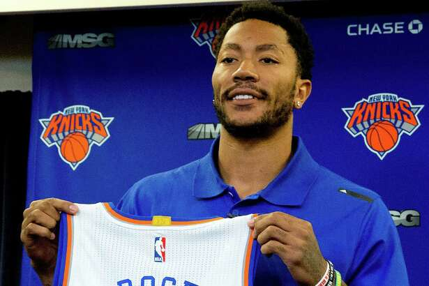 Derrick Rose poses for photographers  with his New York Knicks jersey during a news conference at Madison Square Garden, Friday, June 24, 2016 in New York. The Knicks introduced Rose, the former NBA basketball MVP they acquired from the Chicago Bulls. (AP Photo/Mary Altaffer) ORG XMIT: NYMA105