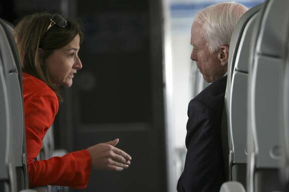 Republican presidential candidate, Sen. John McCain, R-Ariz., right, speaks to press secretary Brooke Buchanan on the campaign charter airplane before take off from Denver, Colo., en route to Phoenix, Ariz., Friday, May 2, 2008. (AP Photo/Mary Altaffer)