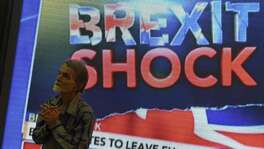 An Indian pedestrian gestures as he stands near a large screen showing news of Britain's vote to exit the European Union in Mumbai on June 24, 2016.  The pound collapsed to a 31-year low and there was pandemonium on currency, equity and oil markets on June 24 as Britain voted to leave the European Union, fuelling a wave of global uncertainty. Sterling crashed 10 percent to $1.3229 at one point, its weakest level since 1985, while the greenback itself slumped below 100 yen for the first time in two-and-a-half years as traders fled to safety.  / AFP PHOTO / PUNIT PARANJPEPUNIT PARANJPE/AFP/Getty Images