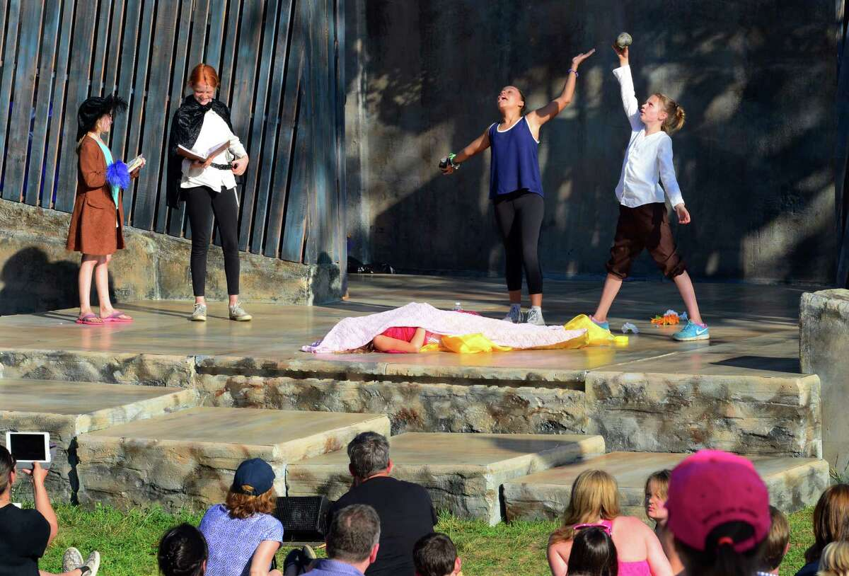 Shakespeare on the Sound campers from ages 9-13, perform Hamlet Jr., an abridged production of Hamlet for audience members as part of Family Night! before the company's main stage production of Hamlet at Pinkley Park on Rowayton Avenue in Norwalk, Conn. on Friday June 24, 2016. Some of the other activities for kids included face painting with a Shakespearean theme and crafts at the First Folio Kids Corner. Performances will be held through July 3. Every evening at 7:30 p.m., except Mondays. Tuesday-Thursday, performances are free. On Fridays, Saturdays and Sundays admission is $20, $10 for seniors and children 13 and older. For more info call 203-299-1300, or visit www.shakespeareonthesound.org