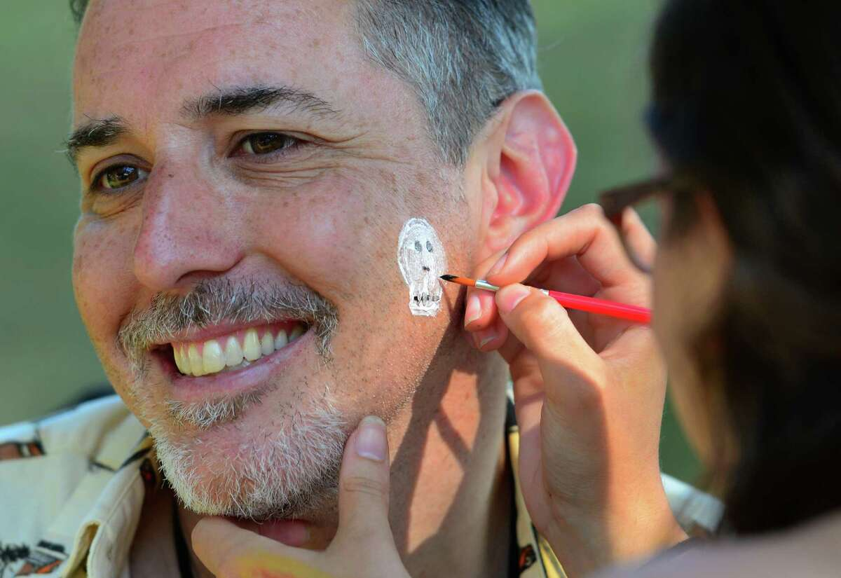 Shakespeare on the Sound Executive Producer Robert Levinstein gets a skull and bones face painting during Family Night! held before the company's main stage production of Hamlet at Pinkley Park on Rowayton Avenue in Norwalk, Conn. on Friday June 24, 2016. Before the main production, Shakespeare on the Sound campers from ages 9-13, performed Hamlet Jr., an abridged production of Hamlet for audience members as part of Family Night! Some of the other activities for kids included face painting with a Shakespearean theme and crafts at the First Folio Kids Corner. Performances will be held through July 3. Every evening at 7:30 p.m., except Mondays. Tuesday-Thursday, performances are free. On Fridays, Saturdays and Sundays admission is $20, $10 for seniors and children 13 and older. For more info call 203-299-1300, or visit www.shakespeareonthesound.org