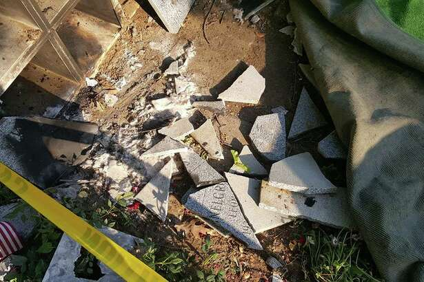 Granite shards from a slab covering shelves for urns lie on the ground after a thief reportedly blew them off and took the containers, ashes and all on June 23, 2016.