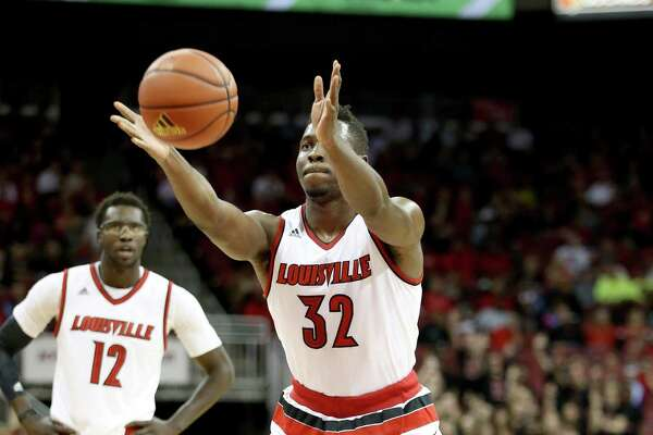 Center Chinanu Onuaku displays his unique free-throw shooting form during a Louisville game. He improved from 47 to 59 percent by shooting underhanded.