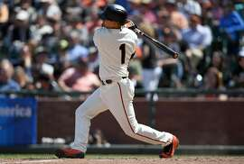 SAN FRANCISCO, CA - JUNE 15:  Ramiro Pena #1 of the San Francisco Giants hits a two-run rbi single against the Milwaukee Brewers in the bottom of the eighth inning at AT&T Park on June 15, 2016 in San Francisco, California. The Giants won the game 10-1.  (Photo by Thearon W. Henderson/Getty Images)