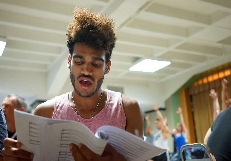 In this June 20, 2016 photo, gay Cuban choir Mano a Mano member Carlos Raul Torres rehearses with the Gay Men's Chorus of Los Angeles. Both choirs have charted history in their respective LGBT communities. Mano a Mano is embarking on its first U.S. tour with a kick-off performance in Los Angeles Saturday. The tour comes as Washington and Havana renew diplomatic relations after decades of hostility.Monday, June 20, 2016 in Los Angeles. (AP Photo/Christine Armario) Photo: Christine Armario, Associated Press