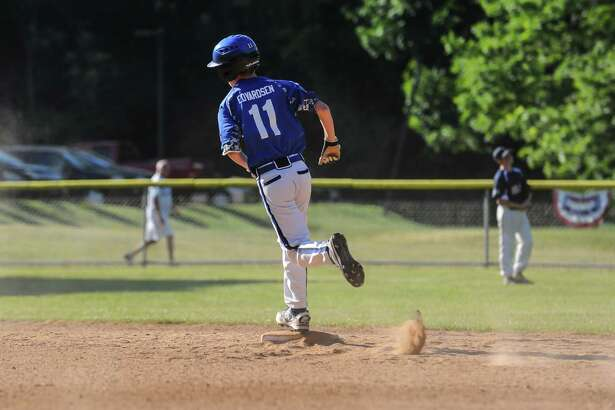 Brendan Edvarsen (11) of Norwalk rounds second base after hitting a two run home run during the Cal Ripken 12U District 1 Championship Game against Stratford on June 24, 2016 in Norwalk, Connecticut.