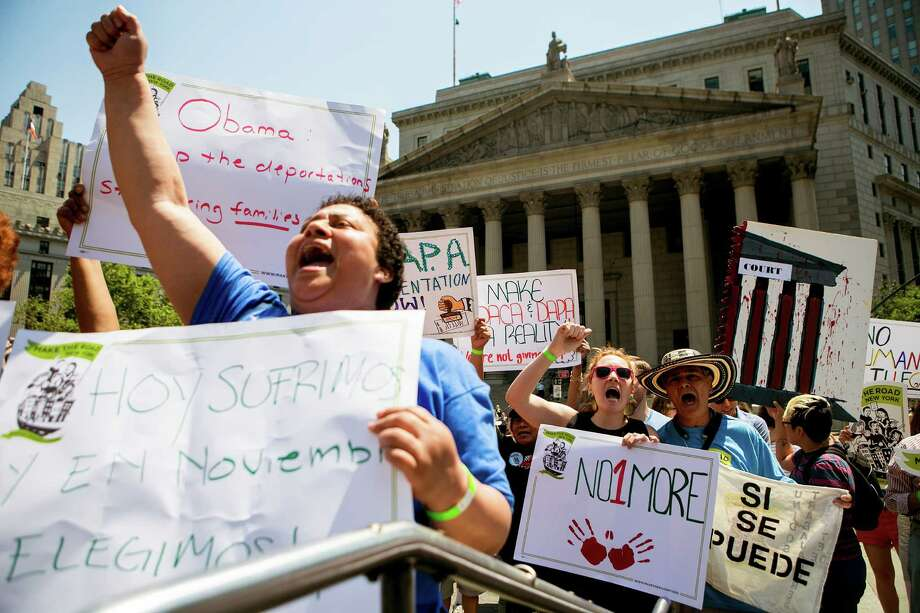Protesters demonstrate over the Supreme Court's ruling on President Barack Obama's immigration policy, at  Foley Square in New York, June 24, 2016. The court's 4-4 tie left in place an appeals court ruling blocking Obama's immigration plan, which would have shielded as many as five million undocumented immigrants from deportation and allowed them to legally work in the United States. (Sam Hodgson The New York Times) Photo: SAM HODGSON, STR / NYT / NYTNS