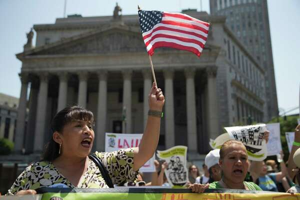 Demonstrators protest against a Supreme Court decision on immigration outside the New York Supreme court, Friday, June 24, 2016, in New York. (AP Photo/Mary Altaffer)