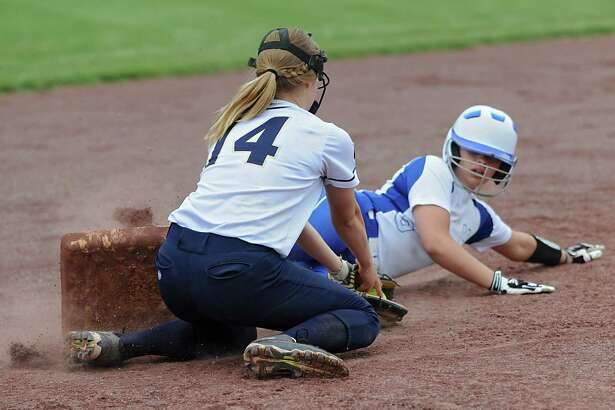Hoosic Valley's Cierra Casale is safe at third as Haleigh Burgess tries to tag her out during a class B semifinal softball game on Tuesday, May 24, 2016 in Malta, N.Y. (Lori Van Buren / Times Union)