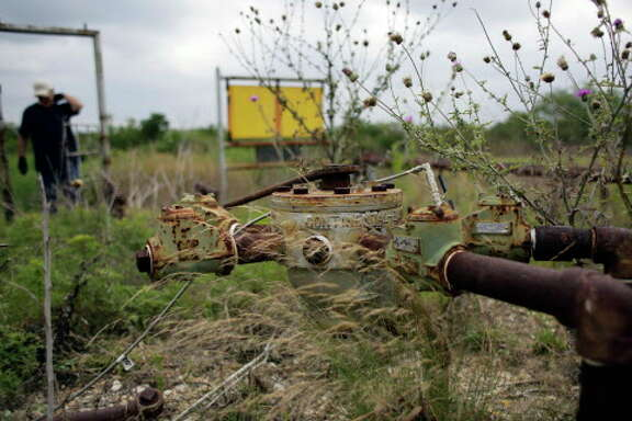 In this Friday, May 13, 2016, photo, a manifold for oil pumps sits idle on a South Texas ranch near Bigfoot, Texas. The agencies that regulate the oil and gas industry are running out of money just as some problems in the oilfields are worsening. Meanwhile, defunct companies are abandoning wells that are in danger of deteriorating. (AP Photo/Eric Gay)