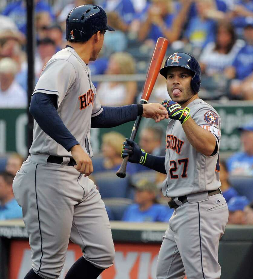 KANSAS CITY, MO - JUNE 24:  George Springer #4 of the Houston Astros celebrates with Jose Altuve #27 after scoring in the first inning against the Kansas City Royals at Kauffman Stadium on June 24, 2016 in Kansas City, Missouri. Photo: Ed Zurga, Getty Images / 2016 Getty Images