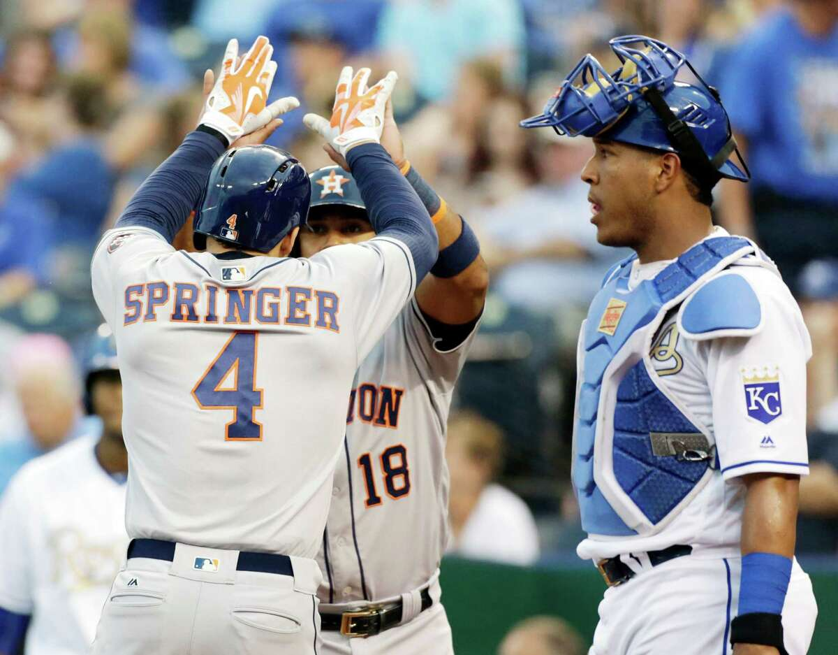June 24: Astros 13, Royals 4 Houston Astros George Springer (4) is congratulated by Luis Valbuena (18) at homplate after hitting a grand slam in the first inning of a baseball game against the Kansas City Royals at Kauffman Stadium in Kansas City, Mo., Friday, June 24, 2016. Royals catcher Salvador Perez, right, looks on. (AP Photo/Colin E. Braley)