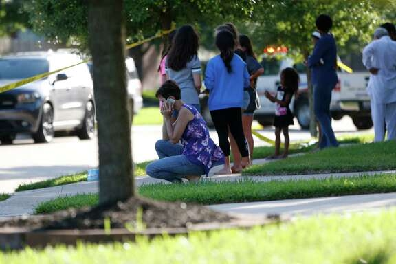 Neighbors gather to watch as Fort Bend County Sheriffs department investigates  a shooting at Blanchard Grove and Remson Hollow, Friday, June 24, 2016, in Katy. ( Karen Warren  / Houston Chronicle )